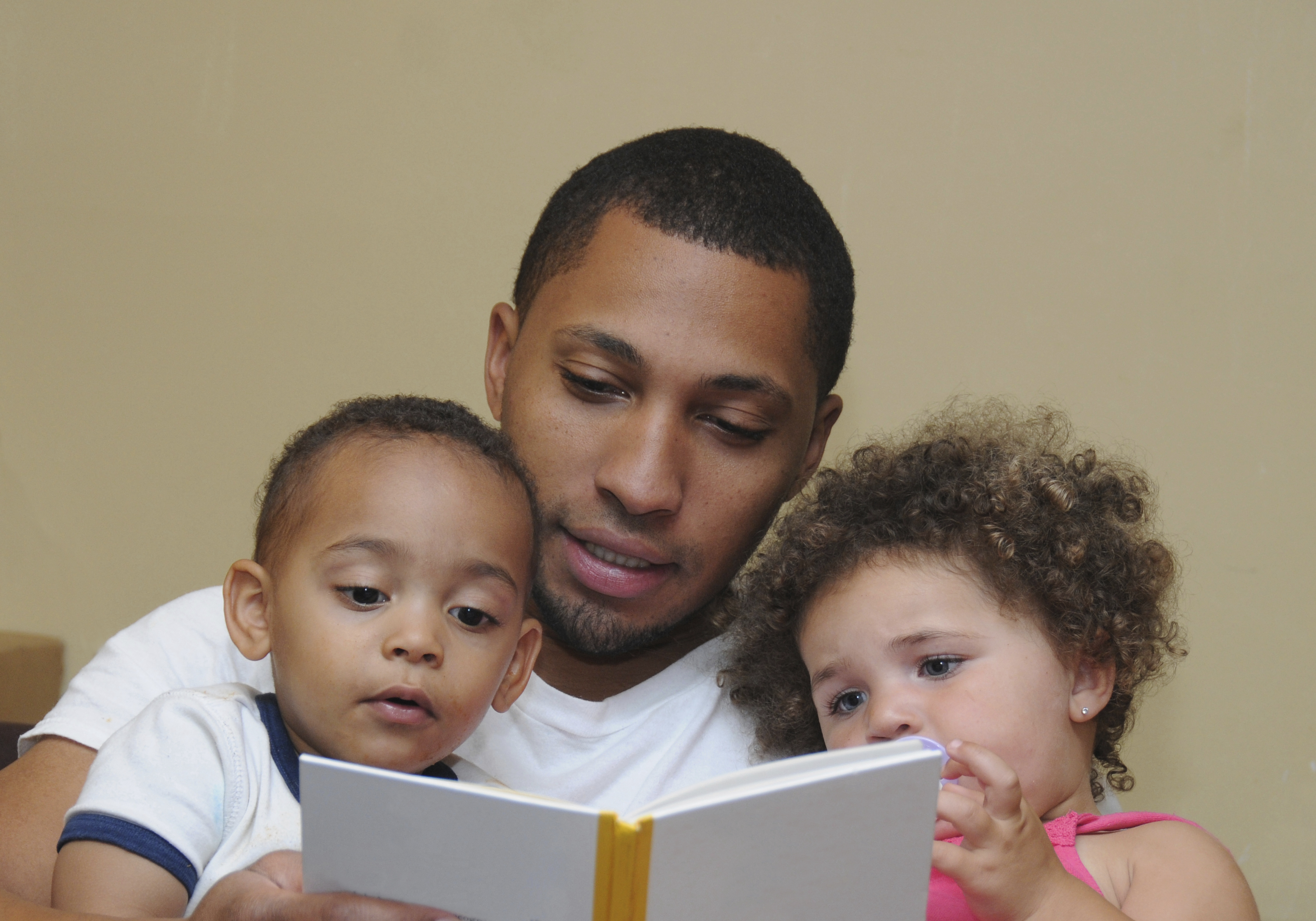 father reading to children on families project volunteers supporting families children's services